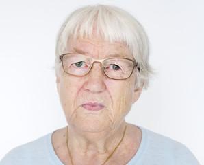 Portrait of serious white elderly woman