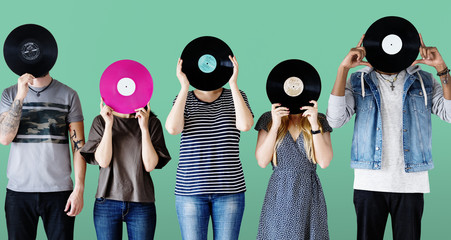 Group of young adults with vinyl disc