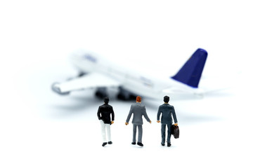 Miniature people : young business with air plane using for business trip concept.