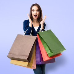Woman in casual clothing with shopping bags