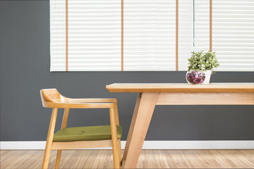 Dining table set with chair in the cozy dining room and dark grey wall