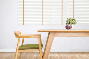 Dining table set with chair in the cozy dining room.
