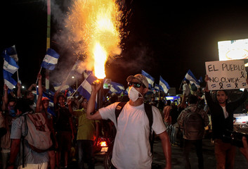 A demonstrator fires a homemade mortar during a demonstration to remember the victims killed during protest in Managua