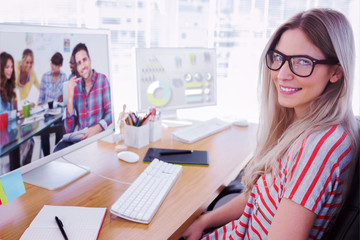 Attractive photo editor working on computer against handsome designer sit in his office