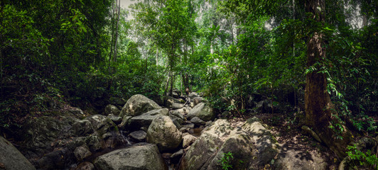 Waterfall Chan Ta Then in the jungles of Thailand. Big panorama. Boulders in the forest.