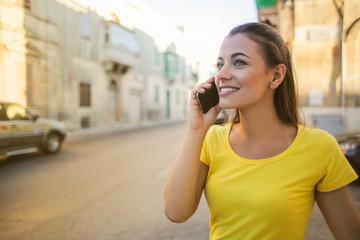 Cheerful girl using a smartphone