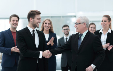 handshake of business partners after a business conference