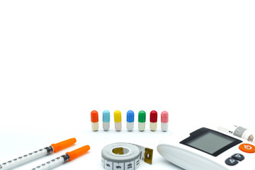 medical office with Piill capsules Glucose meter and medical stethoscope,concept of diabetes, healthy lifestyles and nutrition