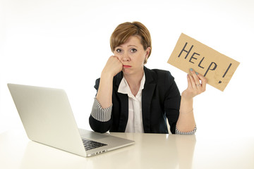 Attractive young tired and frustrated business woman working on her computer asking for help
