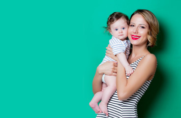 young mother and child on green background
