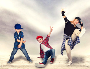 Mother and two son dance hip-hop.Urban lifestyle. Hip-hop generation.