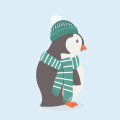 Cute penguin with green hat and scarf