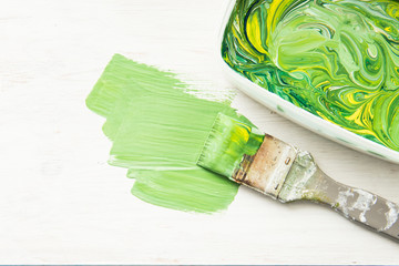 Brush green and yellow paint on white background
