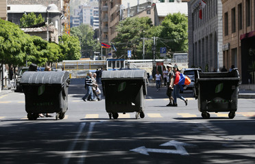 Garbage bins blocking the road are seen after protest movement leader Nikol Pashinyan announced a nationwide campaign of civil disobedience in Yerevan