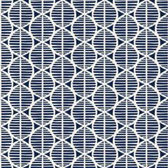 Indigo dye woodblock printed seamless ethnic floral pattern. Primitive oriental ornament, stylized leaves with stripes, ecru on navy blue on ecru background. Textile design.