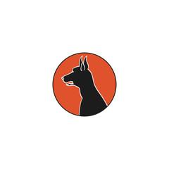 The head of a Doberman emblem
