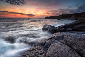 Sunrise at rocky coastline / Magnificent sunrise view at the Black sea coast, Bulgaria