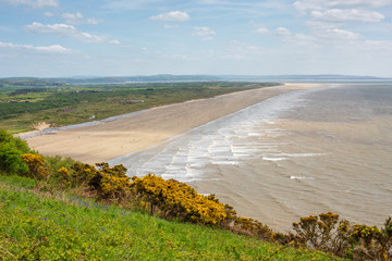 7 Mile stretch of flat beach at Pendine Sands in Carmarthenshire, Wales in the United Kingdom.