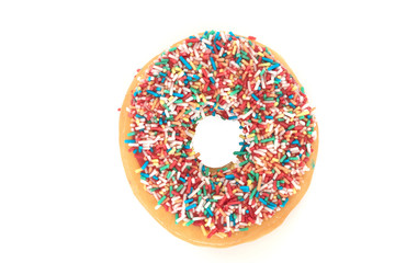 Donut with colorful sprinkles isolated on white background