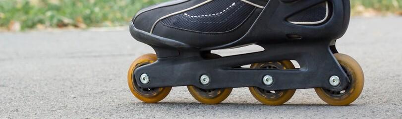 Banner of Roller skate on Asphalt Close-up