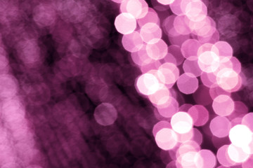 Abstract, colorful, blurry christmas background. Glowing and sparkling lights during night.