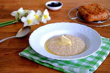 Sweet oatmeal with butter for breakfast