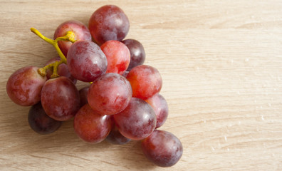 Fresh grape  on wet wooden table,selective focus