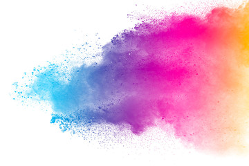 Multi color powder explosion isolated on white background. Color dust splash cloud on white background. Launched colorful particles on background. Wall mural