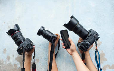 Technology of camera,Development of camera,various camera on the blue wall,Hold hands with favorite camera