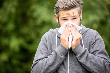 Man with allergy or ill with hay fever