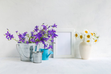 Mockup with a white frame and summer flowers