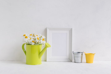 Mockup with a white frame and white daisies