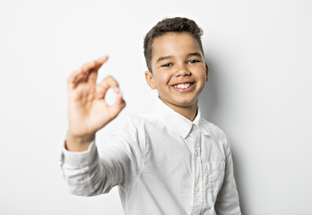 black boy perfect hand sign on studio white background