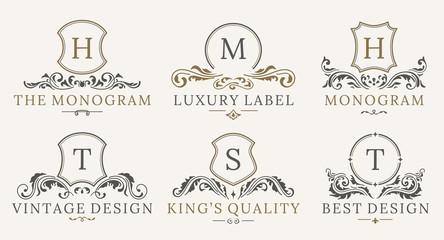 Retro Royal Vintage Shields Logotype set. Vector calligraphyc Luxury logo design elements. Business signs, logos, identity, spa, hotels, badges