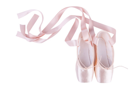 Pink ballet shoes isolated on a white background
