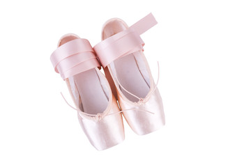 Top view of pink ballet shoes isolated on a white background
