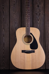 Classical acoustic guitar on wooden background