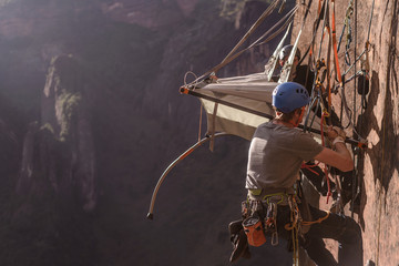 Rock climbers setting up camp