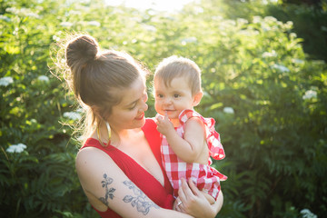 Woman and baby girl in garden