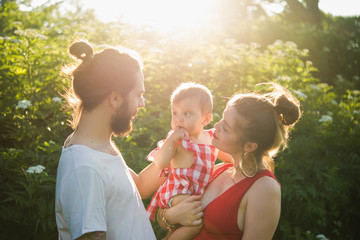 Couple with baby girl in garden