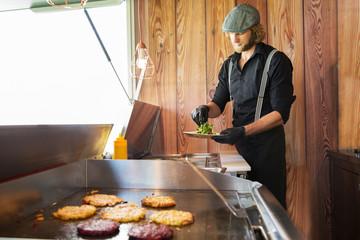 Cook working in food truck, Innsbruck Tirol, Austria