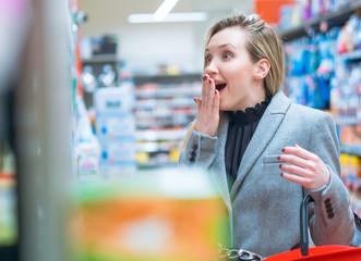 Disbelief. Surprised woman in supermarket