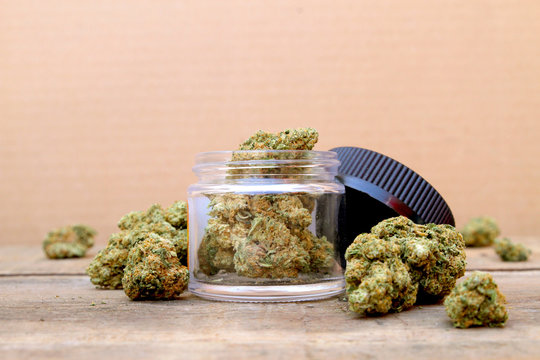 Marijuana in Open Jar Surrounded by Buds - Centered (Green Crack, Sativa Dominant Hybrid Straint)