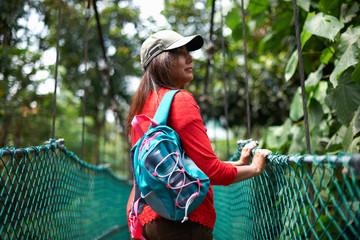 Tourist on bridge, KL Forest Eco Park, Kuala Lumpur, Malaysia
