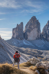 Hiker enjoying view, Dolomites near Cortina d'Ampezzo, Veneto, Italy