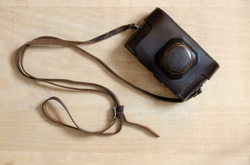 Vintage camera on a wooden desk