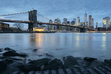 Cityscape with Brooklyn Bridge and Lower Manhattan skyline at dusk, New York, USA