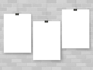 Posters on binder clips. White notepad paper templates. Brick wall. Business. Canvas. Interior. Realistic vector illustration. Empty mockup frames for your drawings, quotes or lettering.