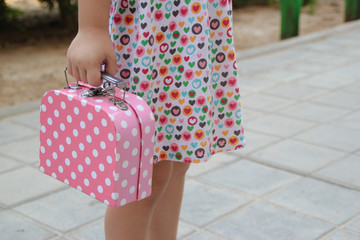 girl with pink suitcase toy