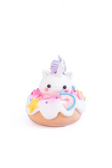 Unicorn donut isolated on a white background. Gingerbread doughnut with a baby unicorn made from sugar icing.